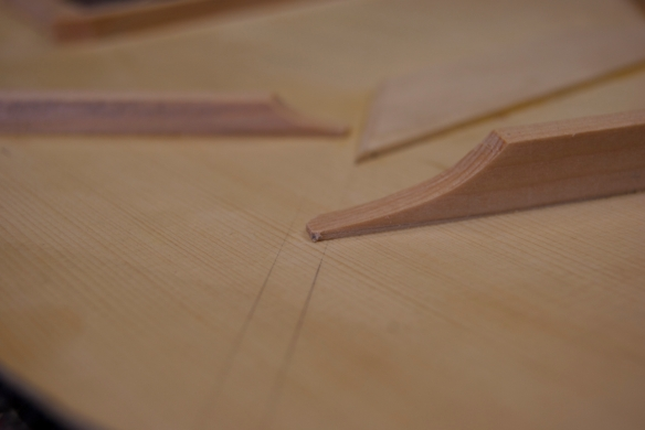 The tone bar (in the foreground) and finger brace (in the background), having carved the ends to fit into the X brace.
